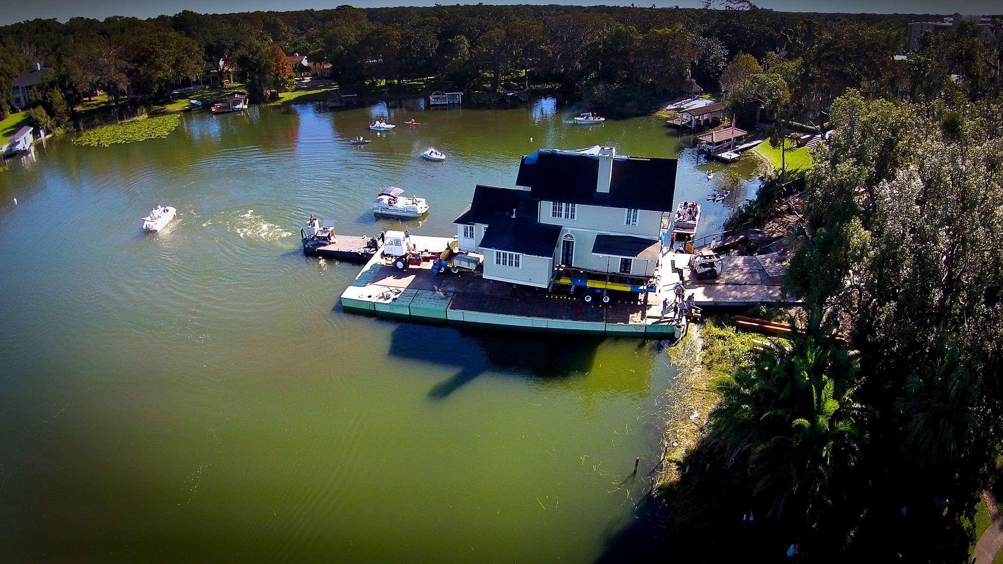 capen house moving across lake osceola on a barge albin polasek
